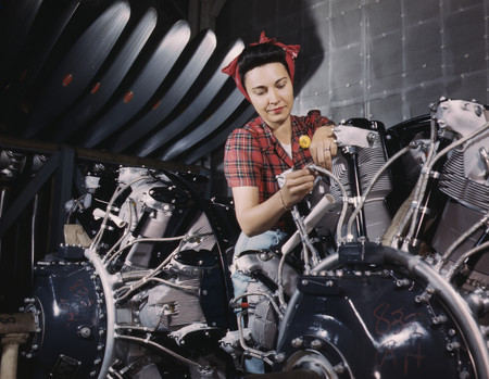 Free Photo: Riveter Woman Working on Wires of a Motor