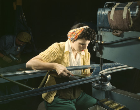 Free Photo: Riveter Operating a Riveting Machine